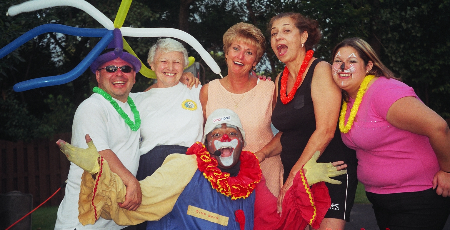 Donny in clown suit laughing with friends